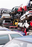 Cars in junkyard. Piled up destroyed cars in the junkyard Royalty Free Stock Photo