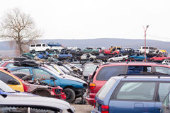 Cars in junkyard. Piled up destroyed cars in the junkyard Royalty Free Stock Images