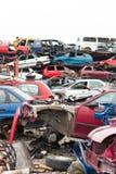 Cars in junkyard. Piled up destroyed cars in the junkyard Stock Photos