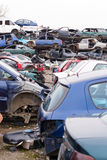 Cars in junkyard. Piled up destroyed cars in the junkyard Stock Photo