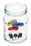Cars and keys in open glass jar Stock Image