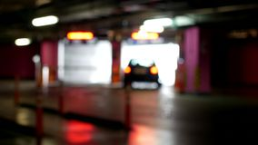 Cars leave from the underground parking, blurred. Cars leave from the underground parking, leaves, blur stock footage