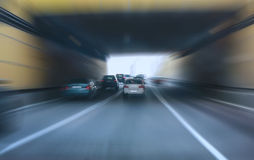 Cars leaving tunnel in downtown Stock Photography