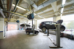 Cars on lifts in small service station Royalty Free Stock Photography