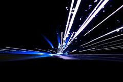 Cars light trails on a curved highway at night. Night traffic trails. Motion blur. Night city road with traffic headlight motion. Cityscape. Light up road by stock images