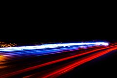 Cars light trails on a curved highway at night. Night traffic trails. Motion blur. Night city road with traffic headlight motion. Cityscape. Light up road by royalty free stock photos