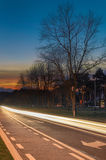 Cars light trails at sunset Royalty Free Stock Image