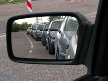 Cars in the line. Cars line up in rearview mirror royalty free stock photo