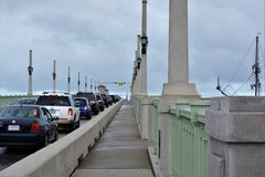 Cars line up on The Bridge of Lions Stock Photos