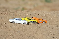 Cars Lined Up. Three toy cars lined up, ready to race Royalty Free Stock Images