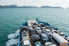 Cars loaded on a ferry and headed for the island Royalty Free Stock Photo