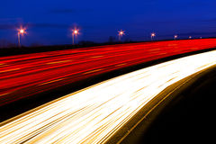 Cars and lorries leave ghostly light trails as they pass by quic Stock Photos