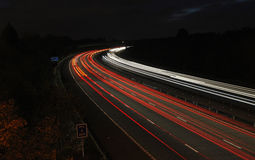 Cars on M3 motorway at night. Cars on M3 motorway in south of England at night time Stock Photos