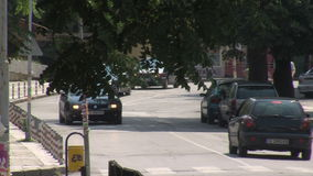 Cars on the main street of Petrich, Bulgaria. Petrich - a small town in seismic zone of Bulgaria, near the border with Greece. Petrich is famous for the fact stock footage