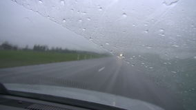 Cars in mist and rain on road stock footage
