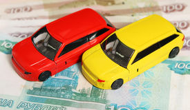 Cars on the moneys. Yellow and red cars on the money Stock Images