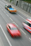 Cars in motion stock photography