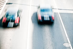 Cars in motion blur Stock Images