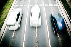 Cars in motion blur Royalty Free Stock Images