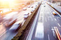 Cars in motion blur on street Royalty Free Stock Photo