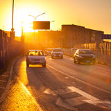 Cars in motion blur on street during sunset Stock Image