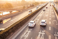 Cars in motion blur on street during sunset Royalty Free Stock Photography