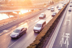 Cars in motion blur on street during sunset Royalty Free Stock Image