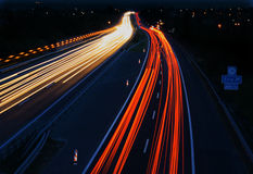 Cars in motion on highway. At night Stock Images