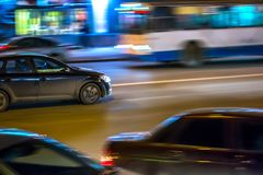 Cars in motion in the night city Royalty Free Stock Photos