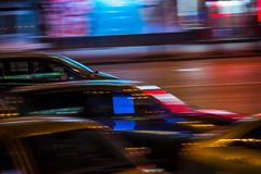 Cars in motion in the night city Stock Images