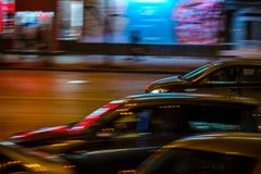 Cars in motion in the night city Stock Image