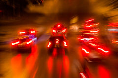 Cars in motion at night Royalty Free Stock Image