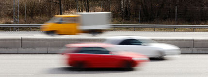 Cars in motion Royalty Free Stock Photos