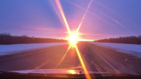 Cars motion traveling on the road winter snow sunlight sunrise travel stock footage