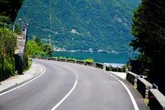 Road along Garda lake , Italy. Cars and motor on Road along Garda lake , Italy stock photography