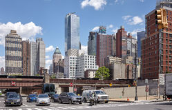Cars and motorbike stop at traffic light in Manhattan Midtown. Royalty Free Stock Photos