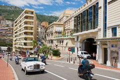 Cars and motorbikes pass by the street in Monaco. MONACO, MONACO - JUNE 17, 2015: Cars and motorbikes pass by the street in Monaco Stock Photo