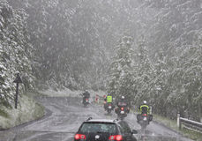 Cars and motorbikes in a snowstorm, Austria Royalty Free Stock Images