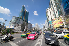 Cars and Motorcycle are waiting for the green light on Asoke Junction. Stock Photography