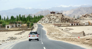 Cars on mountain road in Leh, India Royalty Free Stock Images