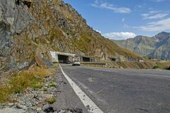 Cars on the mountain road with tunnels at high altitude Stock Photo