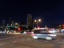 Cars move through intersection at Night Royalty Free Stock Photo