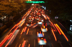 Cars move quickly during rush hour Royalty Free Stock Images
