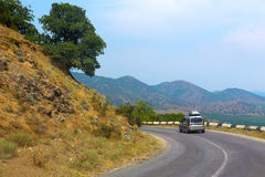 Cars moving along mountain road in Crimea Royalty Free Stock Photo