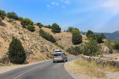 Cars moving along mountain road in Crimea Royalty Free Stock Photography