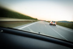 Cars moving fast on a highway Royalty Free Stock Photos