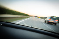 Cars moving fast on a highway Stock Photography
