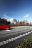Cars Moving Fast On A Highway Stock Photo
