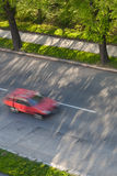 Cars moving fast on a road Royalty Free Stock Photos