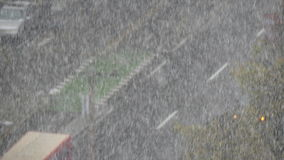 Cars moving snowfall zoom out stock footage